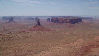 AX136_042 - 6K stock footage aerial video of flying away from Big Indian Butte and Sentinel Mesa, Monument Valley, Utah, Arizona