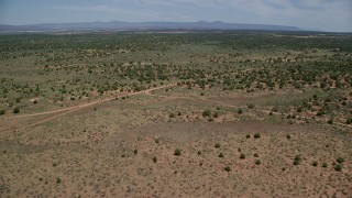AX136_076 - 6K stock footage aerial video of flying over Slick Horn Road and desert valley, Cedar Mesa, Utah