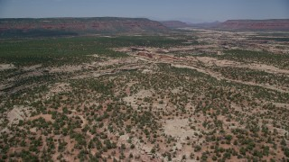 AX136_111 - 6K stock footage aerial video of flying over desert and approaching canyons, Natural Bridges National Monument, Utah