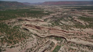 AX136_112 - 6K stock footage aerial video of flying over and panning across shallow canyons, Natural Bridges National Monument, Utah