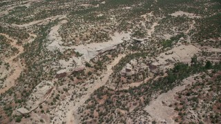 AX136_125 - 6K stock footage aerial video of flying over shallow canyons and desert, Natural Bridges National Monument, Utah