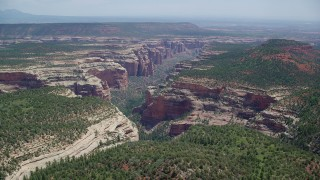 AX136_139 - 6K stock footage aerial video of approaching Arch Canyon, Utah
