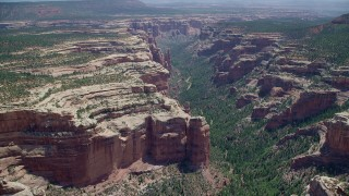AX136_141 - 6K stock footage aerial video of passing by Arch Canyon, Utah