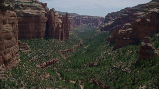 AX136_147 - 6K stock footage aerial video of approaching jagged rock formations while flying through Arch Canyon, Utah