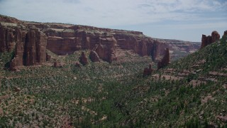 AX136_151 - 6K stock footage aerial video of green trees and rock formations in Arch Canyon, Utah