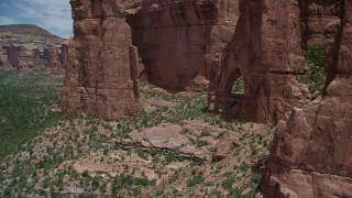 AX136_155 - 6K stock footage aerial video of a close-up view of Cathedral Arch in Arch Canyon, Utah