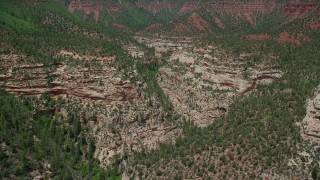 AX136_165 - 6K stock footage aerial video of flying above Arch Canyon, Utah