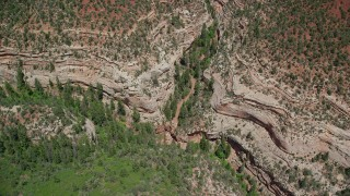 AX136_167 - 6K stock footage aerial video tilt to bird's eye view of Arch Canyon, Utah