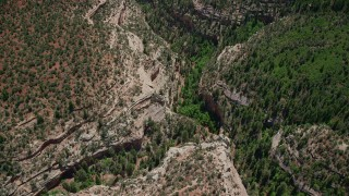 AX136_168 - 6K stock footage aerial video of tilt from bird's eye view of Arch Canyon, Utah, then fly away