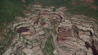 AX136_173 - 6K stock footage aerial video of flying by a box canyon in Manti-La Sal National Forest, Utah