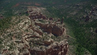 AX136_178 - 6K stock footage aerial video of orbiting rock formations in a forested canyon, Manti-La Sal National Forest, Utah