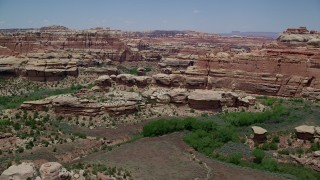 AX136_209 - 6K stock footage aerial video of flying over and approaching rock formations, Canyonlands National Park, Utah