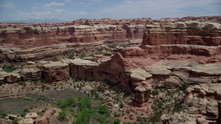 AX136_214 - 6K stock footage aerial video of passing by canyons between rock formations, Canyonlands National Park, Utah