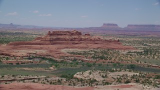 AX136_224 - 6K stock footage aerial video of flying by Squaw Butte at Canyonlands National Park, Utah