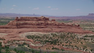 AX136_225 - 6K stock footage aerial video of passing by Squaw Butte at Canyonlands National Park, Utah