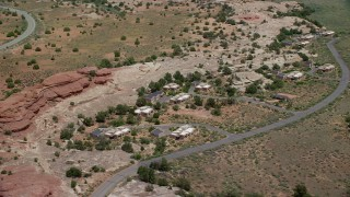 AX136_226 - 6K stock footage aerial video of orbiting rural homes by Residence Road, Canyonlands National Park, Utah