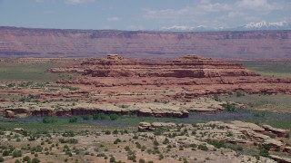 AX136_227 - 6K stock footage aerial video of desert butte in Canyonlands National Park, Utah