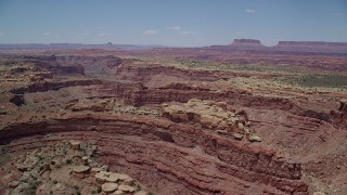 AX136_230 - 6K stock footage aerial video of flying over rock formations and Big Spring Canyon, Canyonlands National Park, Utah