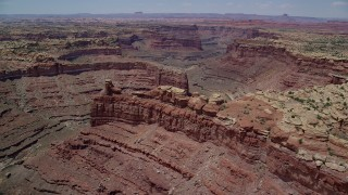 AX136_231 - 6K stock footage aerial video of flying by Big Springs Canyon and rock formations, Canyonlands National Park, Utah