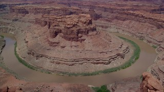 AX136_234 - 6K stock footage aerial video of orbiting Colorado River through Meander Canyon, Canyonlands National Park, Utah