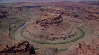 AX136_235 - 6K stock footage aerial video orbit and fly away from Colorado River through Meander Canyon, Canyonlands National Park, Utah