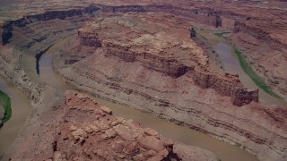 AX136_240 - 6K stock footage aerial video fly over Colorado River and buttes in Meander Canyon, Canyonlands National Park, Utah