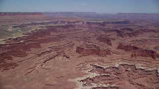 AX136_246 - 6K stock footage aerial video approach buttes and canyons near White Rim cliffs, Canyonlands National Park, Utah