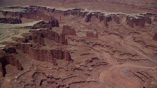 AX136_252 - 6K stock footage aerial video of steep buttes, Monument Canyon, and White Rim in Canyonlands National Park, Utah