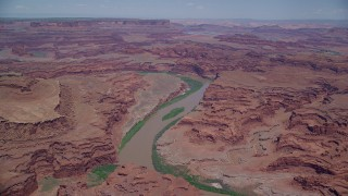 AX136_262 - 6K stock footage aerial video of following the Colorado River through Meander Canyon, Canyonlands National Park, Utah
