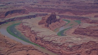AX136_264 - 6K stock footage aerial video of flying by butte, Colorado River in Goose Neck portion of Meander Canyon, Canyonlands National Park, Utah