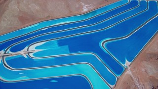 AX136_272 - 6K stock footage aerial video of bird's eye view of potash ponds in a desert valley, Moab, Utah