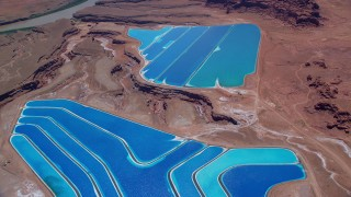 AX136_273 - 6K stock footage aerial video of flying away from potash ponds, Moab, Utah