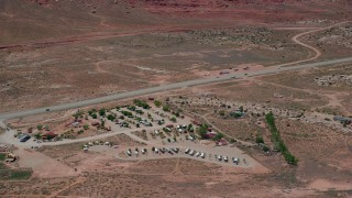 AX136_288 - 6K stock footage aerial video of flying by Archview RV & Resort Campground by Highway 191, Moab, Utah