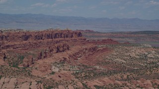 AX137_003 - 6K stock footage aerial video of flying by Klondike Bluffs and Marching Men rock formations, Arches National Park, Utah
