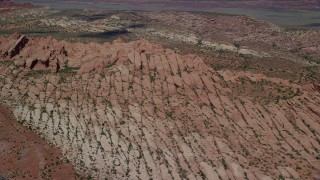 AX137_004 - 6K stock footage aerial video of flying by and tilting to desert rock formations, Arches National Park, Utah