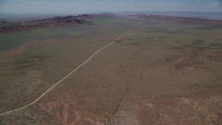 AX137_009 - 6K stock footage aerial video of flying by Arches Scenic Drive through a desert valley, Arches National Park, Utah