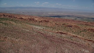 AX137_011 - 6K stock footage aerial video of approaching rock fins in Devil's Garden at Arches National Park, Utah