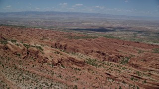 AX137_012 - 6K stock footage aerial video fly over rock fins in Devil's Garden, Arches National Park, Utah