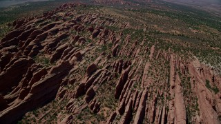 AX137_015 - 6K stock footage aerial video of flying over rock fins in Devil's Garden, Arches National Park, Utah