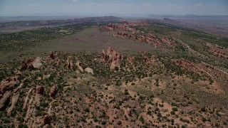 AX137_021 - 6K stock footage aerial video fly over Devil's Garden, approach dry river bed and Eagle Park, Arches National Park, Utah