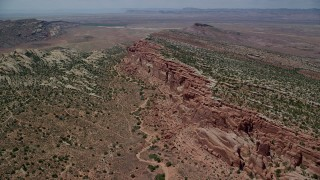 AX137_028 - 6K stock footage aerial video fly over desert vegetation and Eagle Park rock formations, Arches National Park, Utah