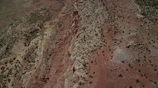 AX137_031 - 6K stock footage aerial video of a bird's eye of desert cliffs in Eagle Park, Arches National Park, Utah