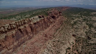 AX137_032 - 6K stock footage aerial video of approaching cliffside rock formations in Eagle Park, Arches National Park, Utah