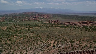 AX137_040 - 6K stock footage aerial video of Eagle's Rock and Devil's Garden in Arches National Park, Utah