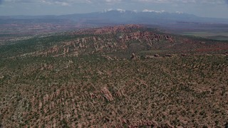 AX137_044 - 6K stock footage aerial video fly over desert rock formations and plants in Devil's Garden, Arches National Park, Utah