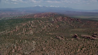 AX137_045 - 6K stock footage aerial video fly over and approach rock formations in Devil's Garden, Arches National Park, Utah