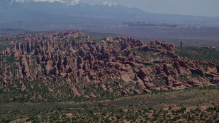 AX137_047 - 6K stock footage aerial video of rock fins and monoliths in Devil's Garden, Arches National Park, Utah