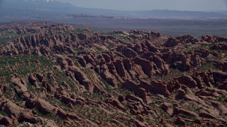 AX137_049 - 6K stock footage aerial video of flying by Devil's Garden rock formations at Arches National Park, Utah