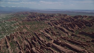 AX137_050 - 6K stock footage aerial video of passing by Devil's Garden rock fins at Arches National Park, Utah