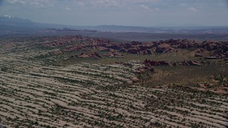 AX137_052 - 6K stock footage aerial video of passing rock formations and desert plants in Devil's Garden, Arches National Park, Utah